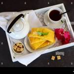 Cheesy Pancakes With Tea On A Wooden Tray Ideas For Breakfast Stock Photo Alamy