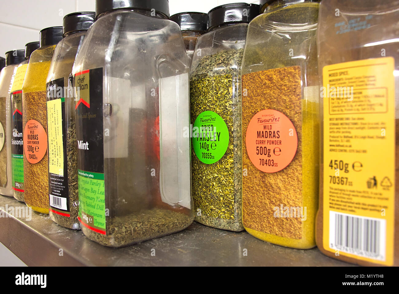 https www alamy com stock photo various spices on shelf in commercial kitchenlarge containers of spices 173330340 html
