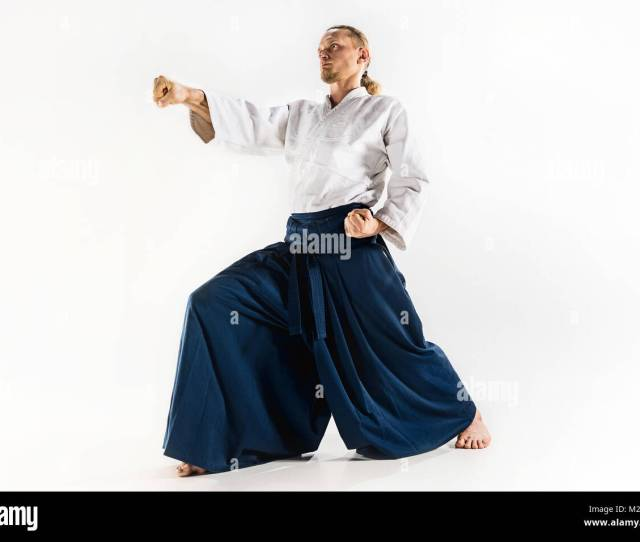 Aikido Master Practices Defense Posture Healthy Lifestyle And Sports Concept Man With Beard In White Kimono On White Background