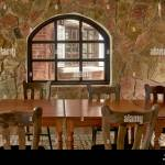 Rustic Stone Built Restaurant Interior With Wooden Tables And Chairs Stock Photo Alamy