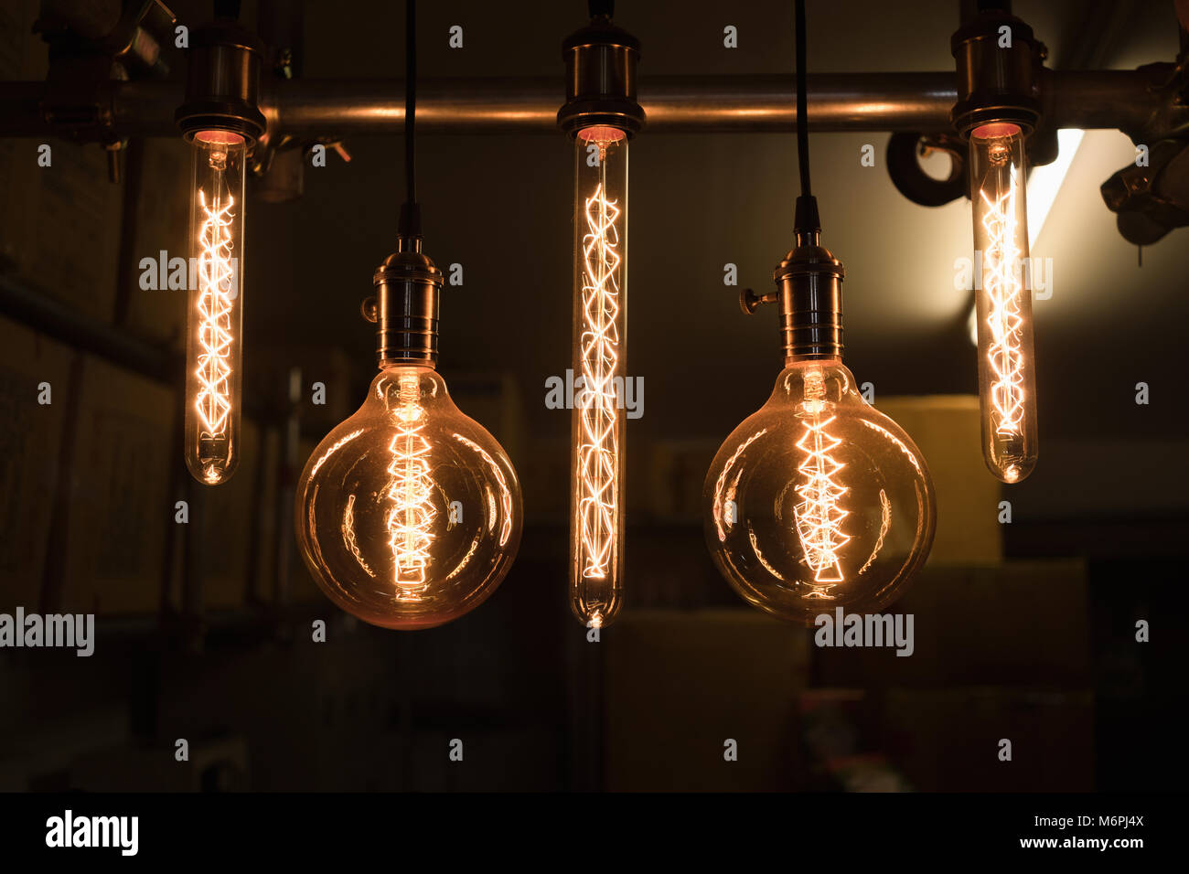 https www alamy com stock photo close up group of hanging light bulbs with storage room background 176288810 html