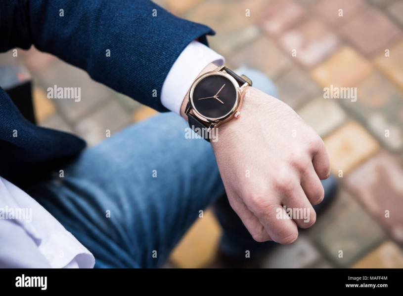 Elegant young business man s hand with fashion no brand wrist watch     Elegant young business man s hand with fashion no brand wrist watch  men  fashion and accessories closeup shot