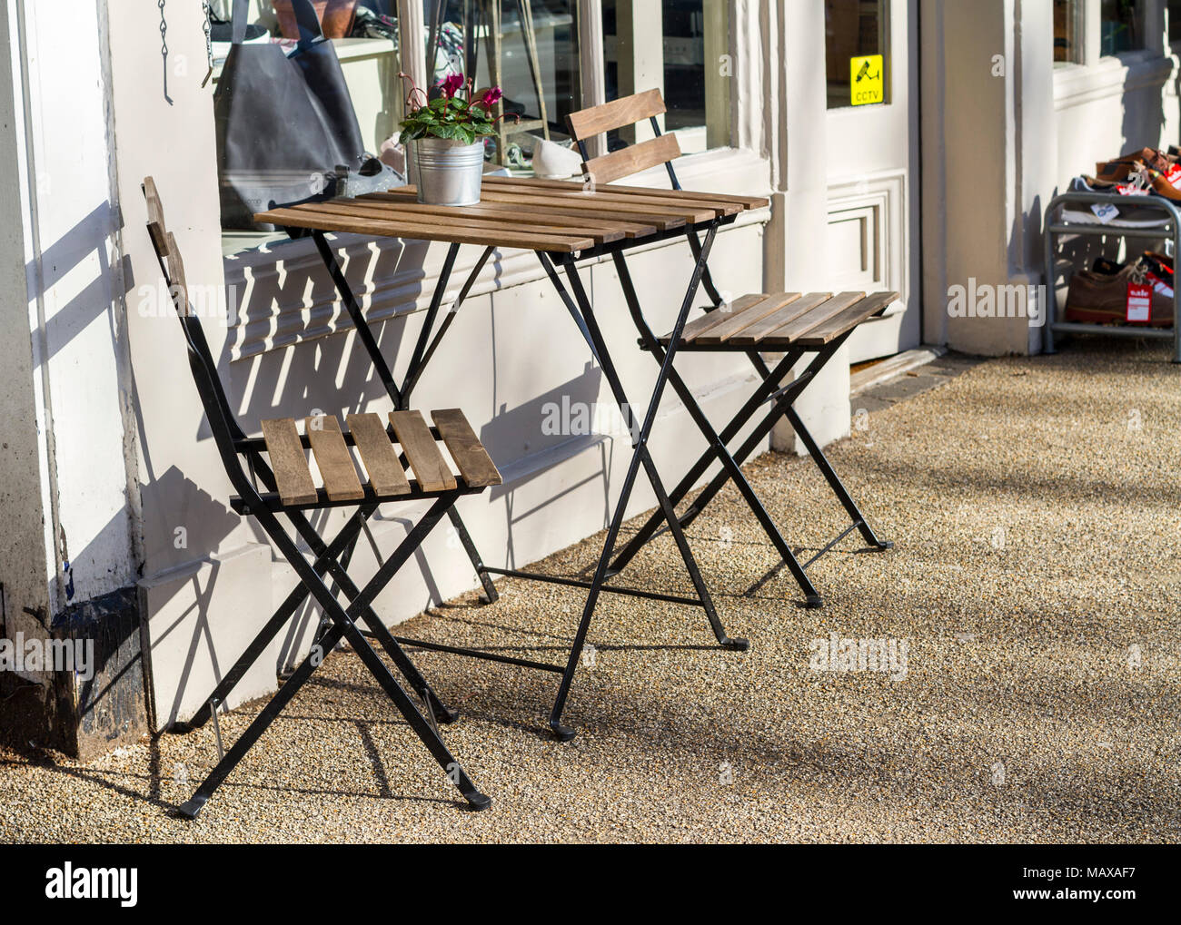 Empty Wooden Table And Chairs Outside A Coffee Shop On A Bright Sunny Day London Uk Stock Photo Alamy