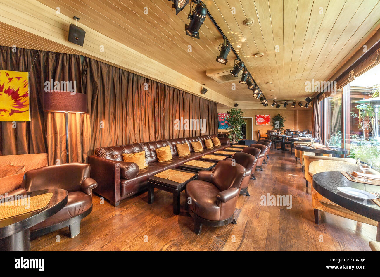 https www alamy com moscow august 2014 interior is luxurious and fine dining restaurant gallery room with luxurious long leather sofa brown image179377358 html