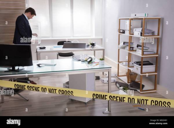 Investigator Collecting Evidence In Office Behind Yellow ...
