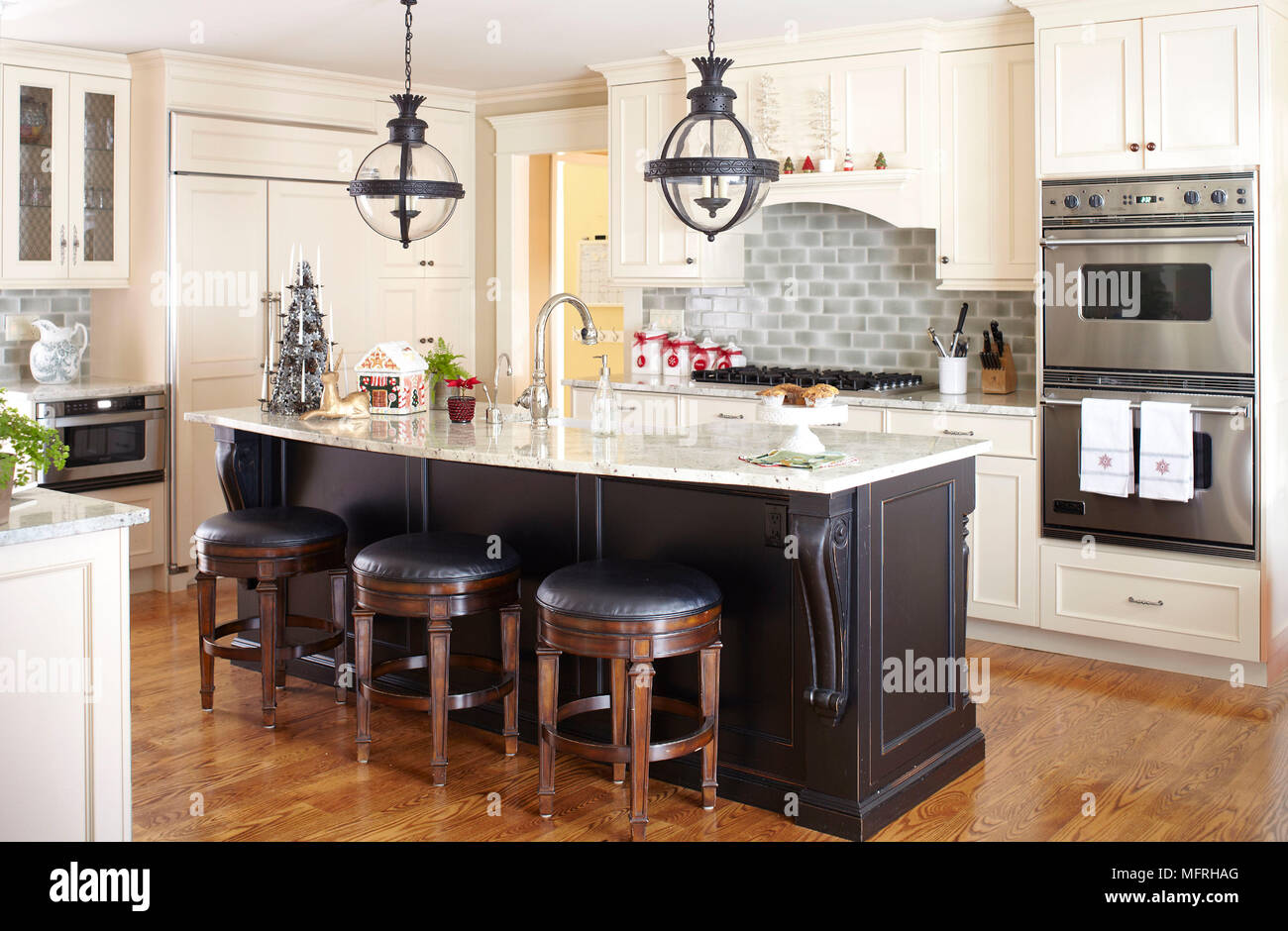 Bar Stools At Kitchen Island Breakfast Bar In Traditional Style Kitchen Fairfield New Jersey Usa Stock Photo Alamy