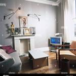 Sitting Room Grey Walls Wooden Floors Fireplace White Curtains Armchairs Television Wall Lights Stock Photo Alamy