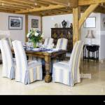 Upholstered Chairs At Wooden Table In Modern Country Style Dining Room Stock Photo Alamy