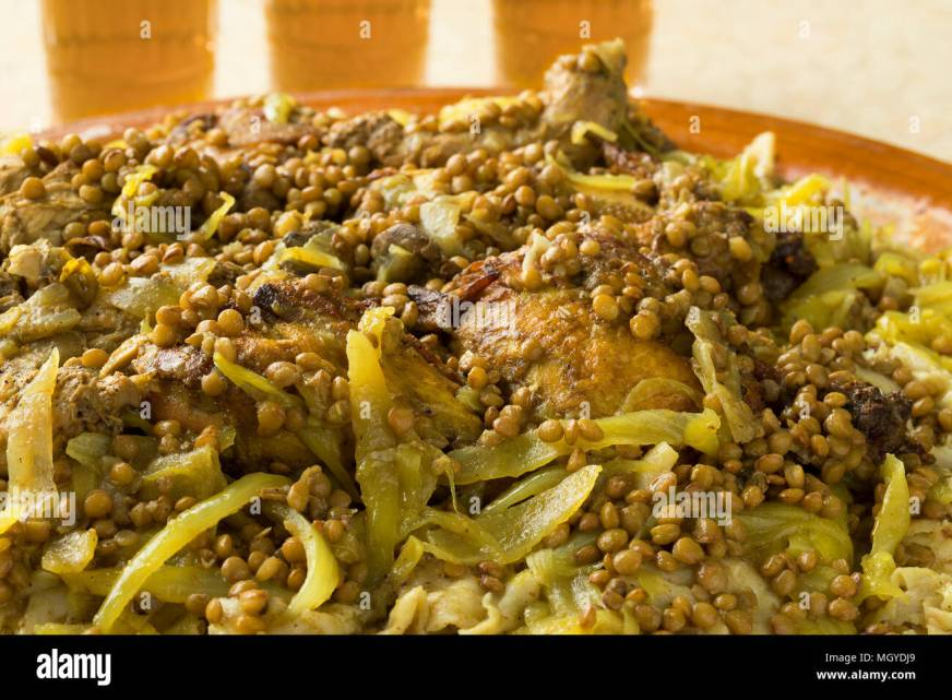 Traditional Moroccan homemade Rfissa close up and tea ...