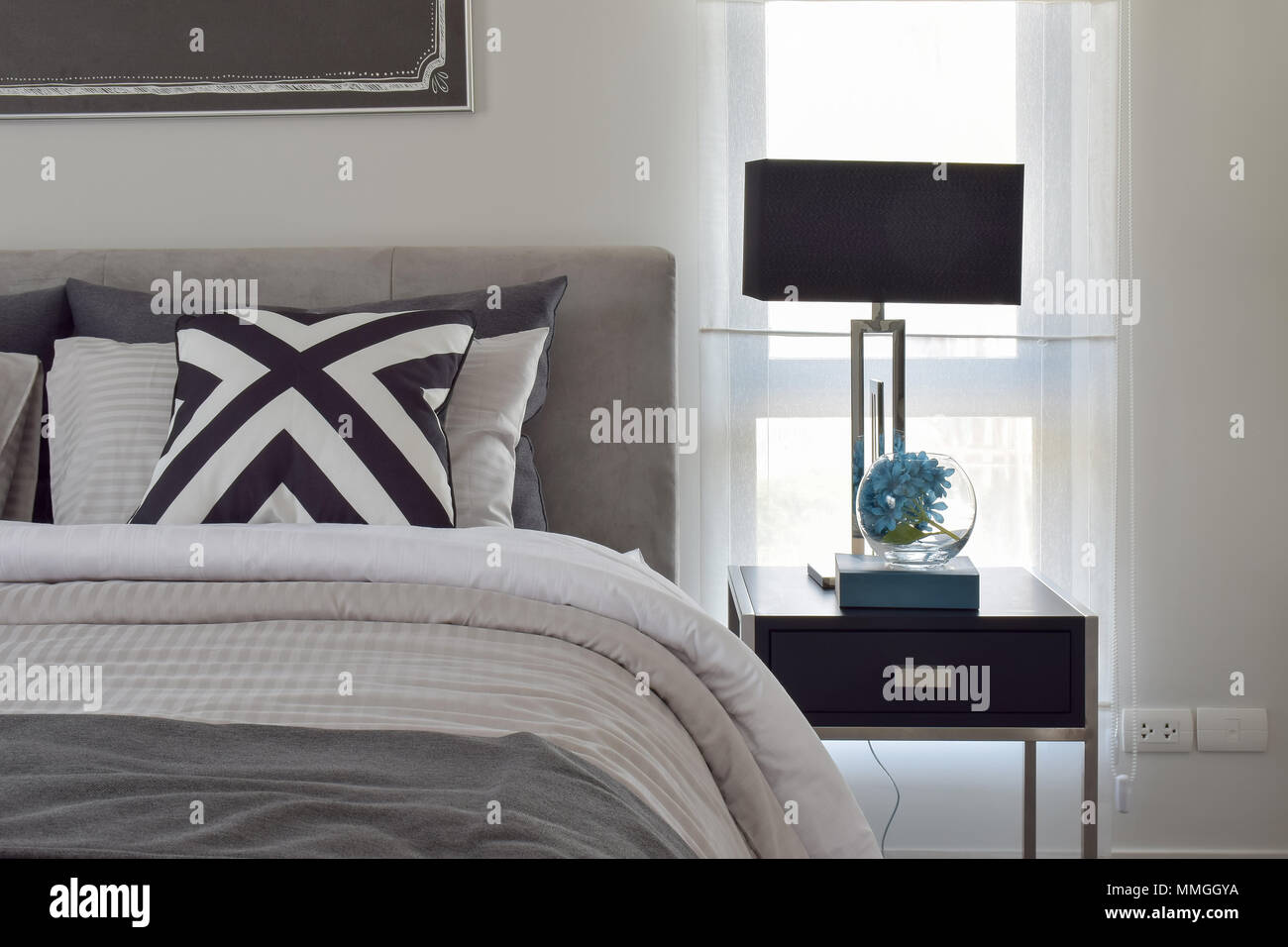 Black Shade Reading Lamp On Bedside Table With Modern Classic Style Bedding Stock Photo Alamy