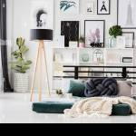 Knot Pillow And Knit Blanket On Mattress Next To Lamp In Scandi Bedroom Interior With Posters Stock Photo Alamy