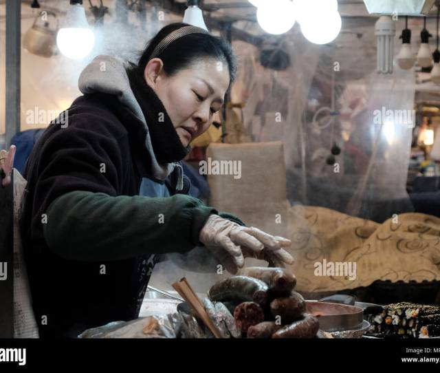 Stallholder Selling Traditional Korean Food In Gwangjang Market In The City Of Seoul Capital Of The Republic Of Korea Commonly Known As South Korea