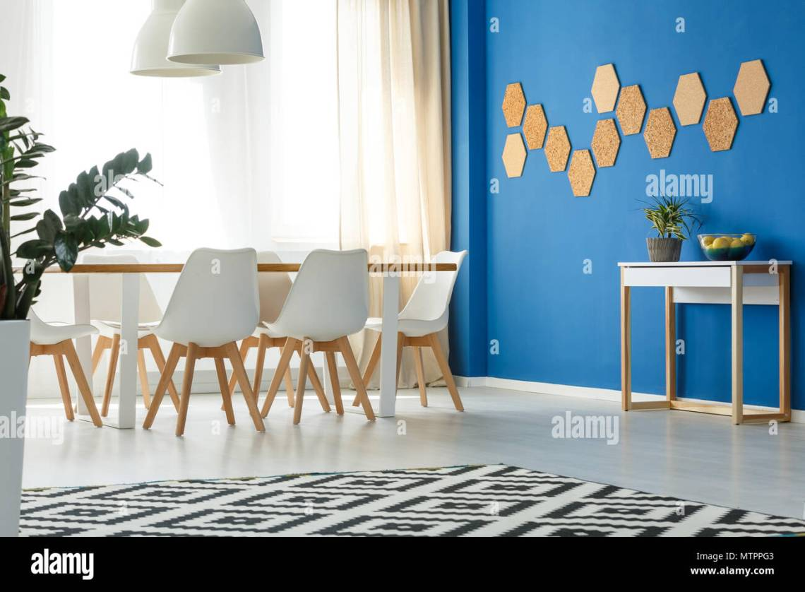 Blue Wall Accent In Minimalist Modern Living Room With Open Dining Area Scandinavian Design Window And Natural Decor Stock Photo Alamy