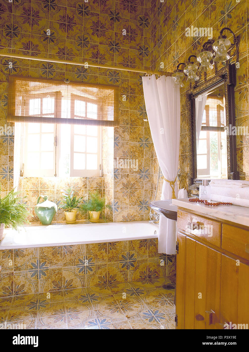 https www alamy com white shower curtain on bath in blueyellow tiled bathroom with open windows above the bath image208940186 html