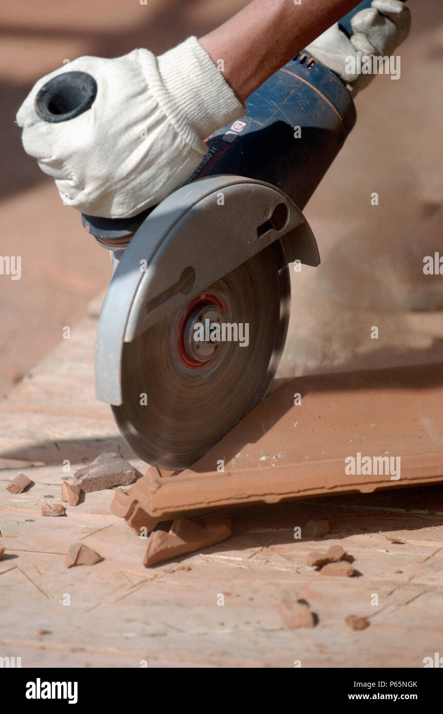 https www alamy com man cutting tiles with circular saw image210339043 html