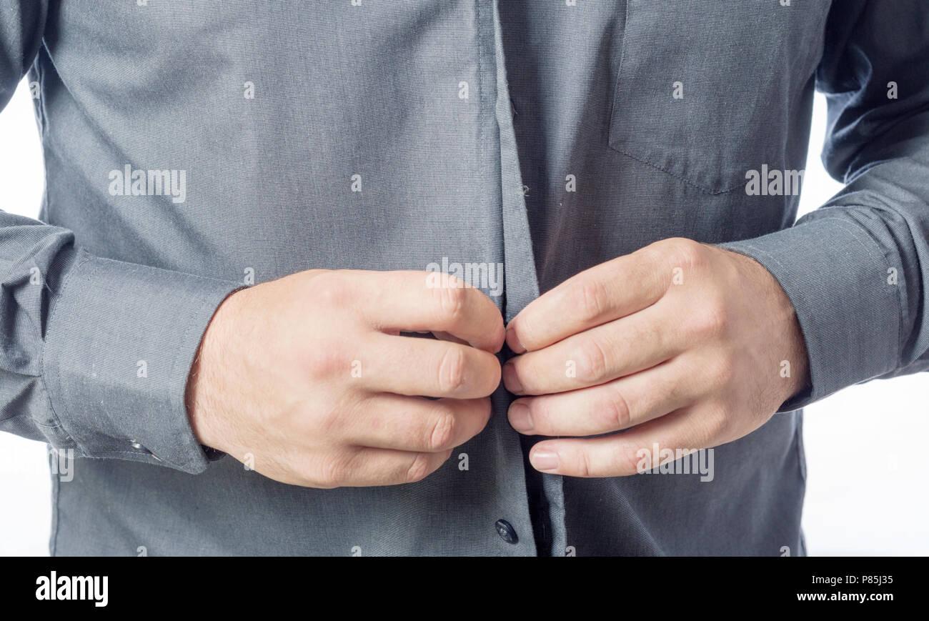 Men Putting On His Shirt Close Up Mens Hands Buttoning The Shirt