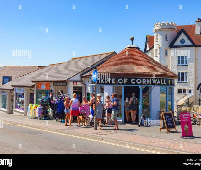 Bude Cornwall Uk In The Continuing Hot Sunny Weather People Cool Off Eating Ice Cream Outside Taste Of Cornwall In Belle View