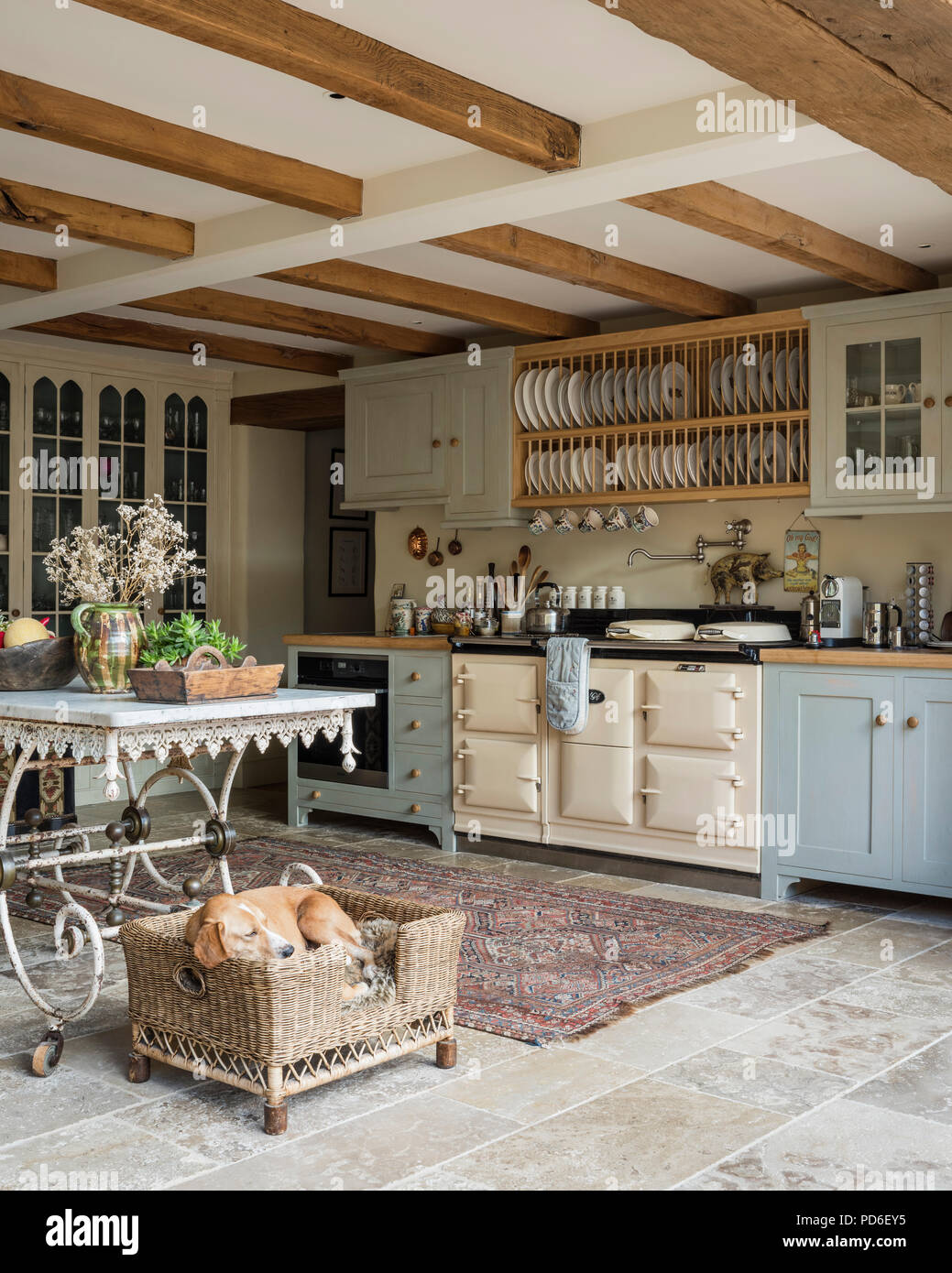 https www alamy com light blue fitted farmhouse kitchen with plate rack and sleeping dog in basket image214658393 html