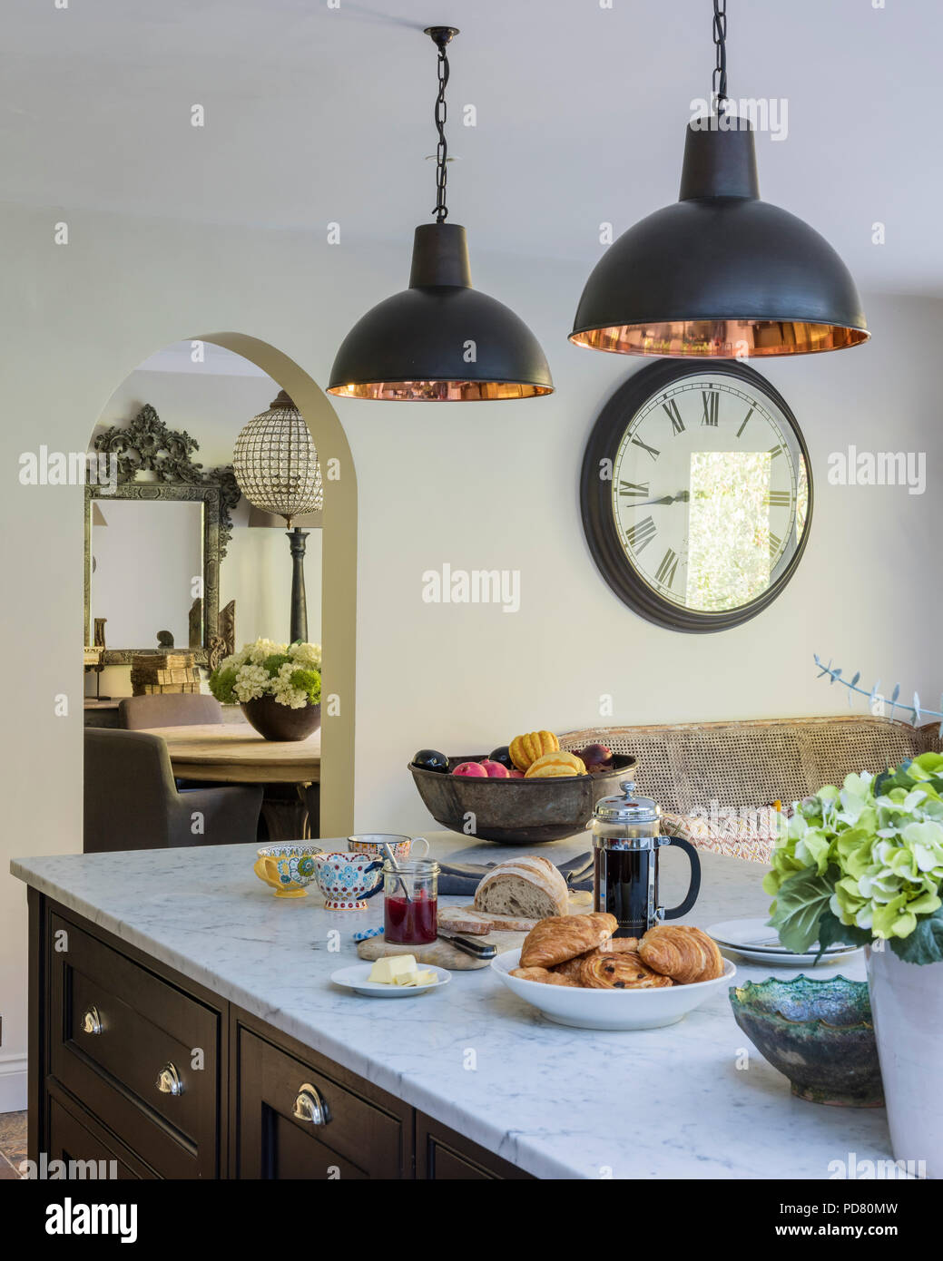 https www alamy com bespoke kitchen island by thomas ford sons is painted in tanners brown by farrow ball industrial style pendant lights hang above the marble work image214691145 html