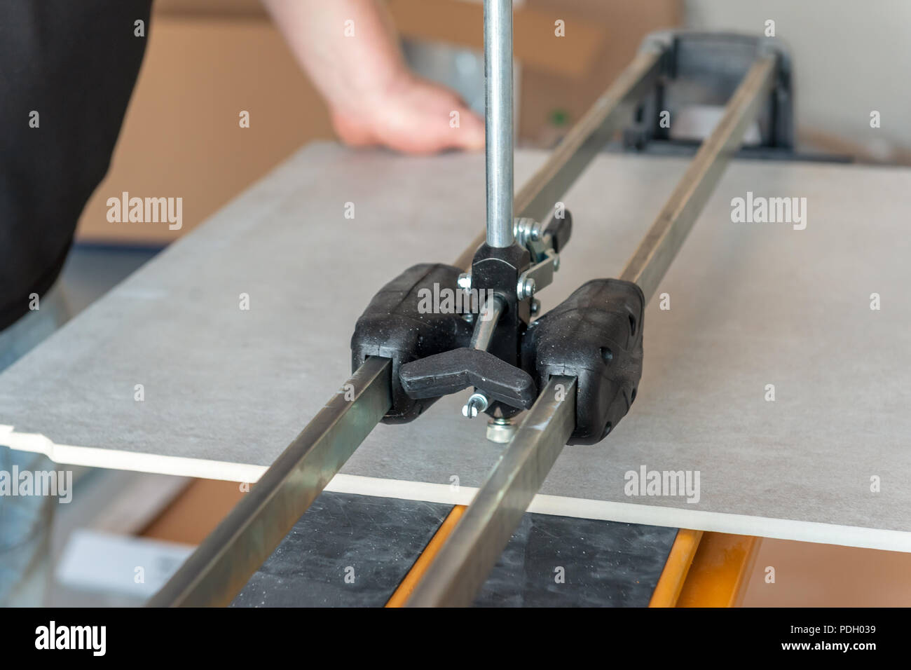 https www alamy com tile cutter machine worker cutting ceramic floor tiles tile with tile cutter image214888221 html