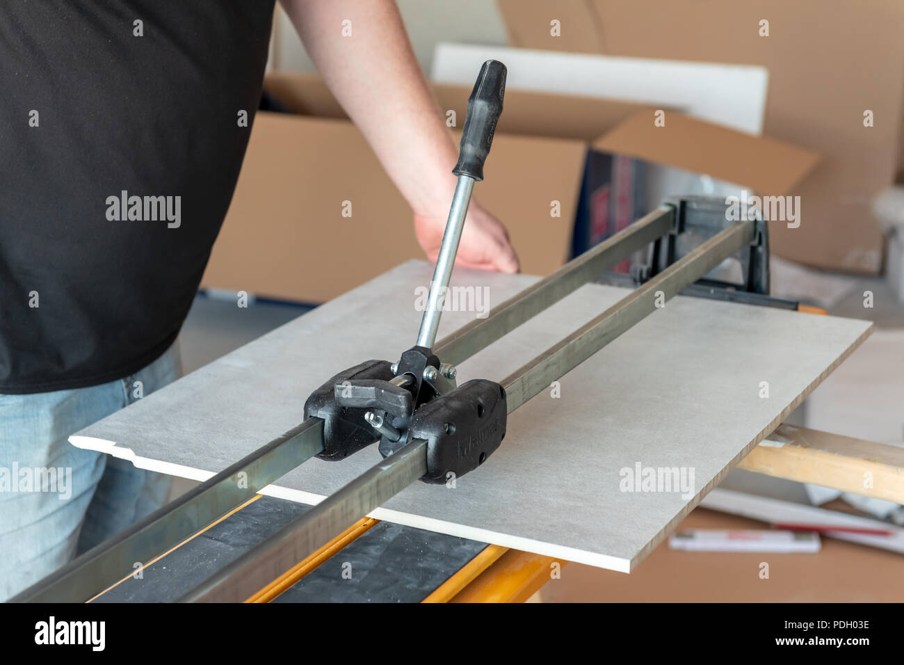 https www alamy com the man is cutting the floor tiles using a tile cutter machine image214888226 html