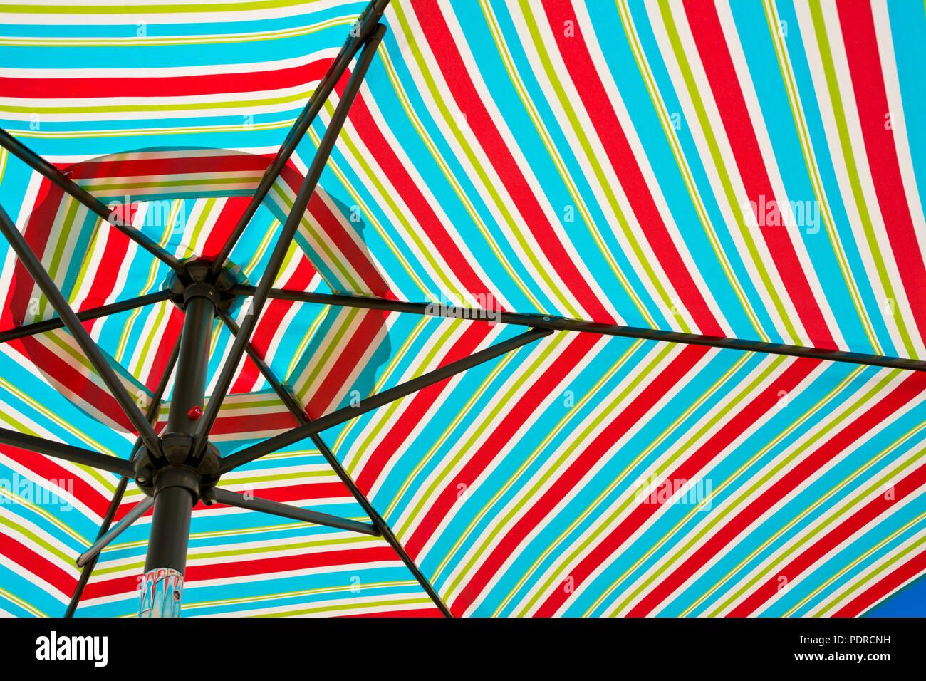 https www alamy com colourful striped beach umbrella closeup of colorful striped pattern on patio umbrella image215029853 html