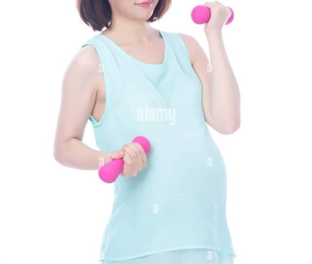 Pregnant Woman Exercising