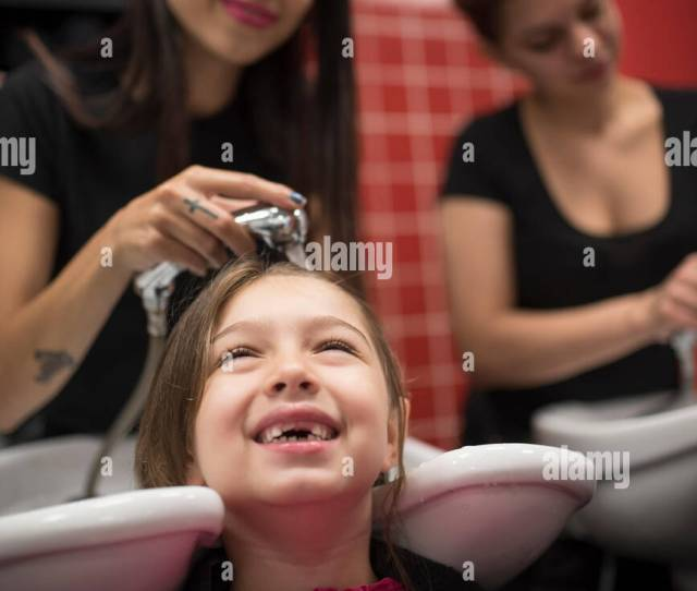 Hairdressers With Little Girls Washing Hair In Sink Stock Image