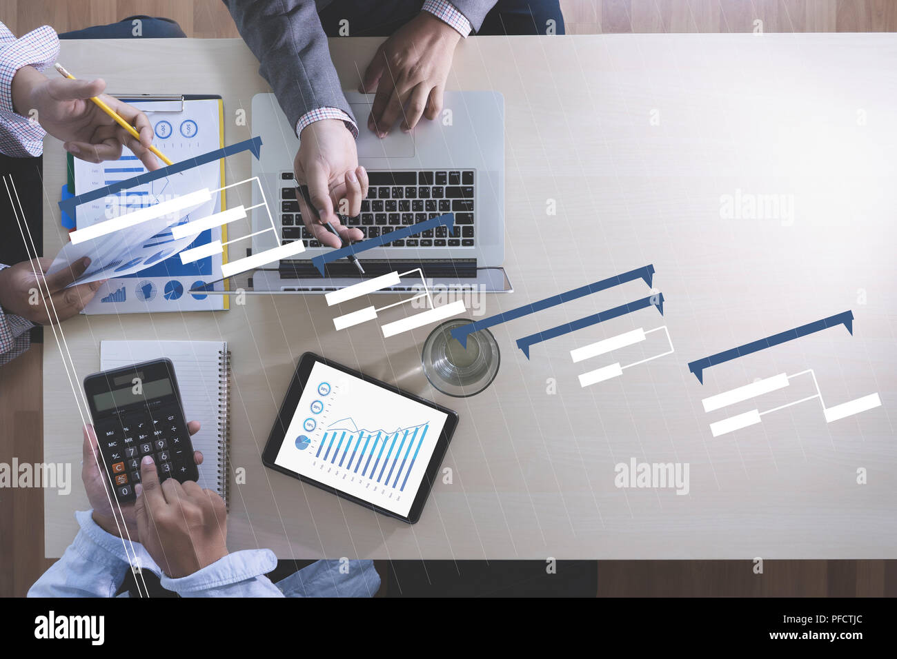 Business People Analyzing PROJECT MANAGEMENT updating Gantt chart     Business People Analyzing PROJECT MANAGEMENT updating Gantt chart