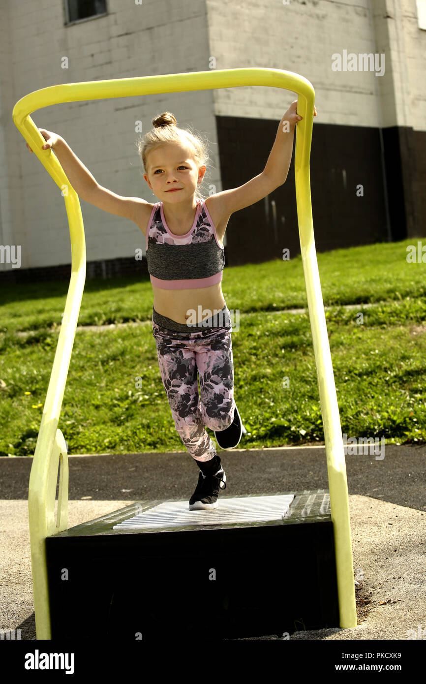 Six Year Old Girl On A Running Machine In A Free To Use Outdoor Fitness Area