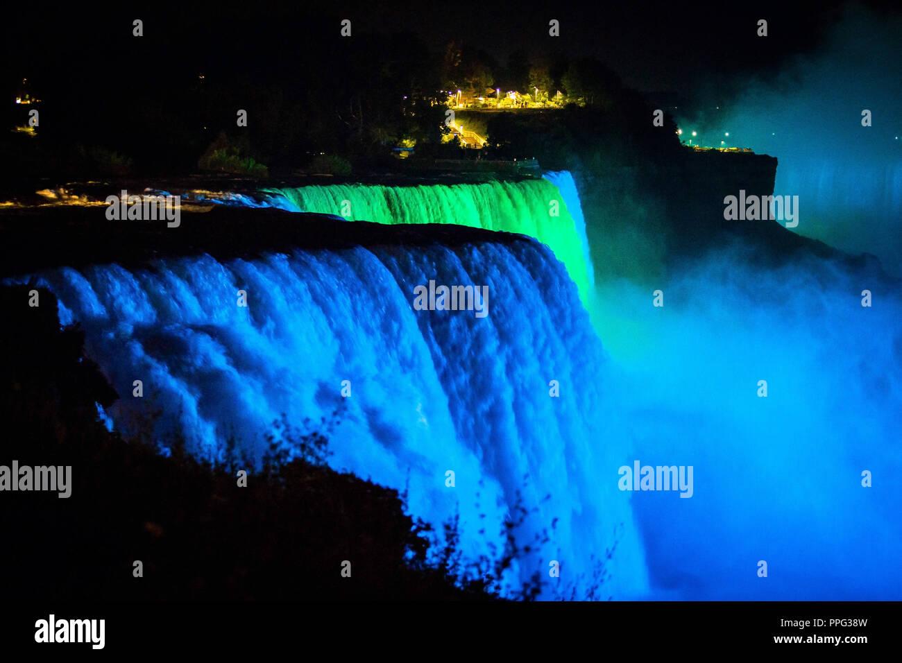 Niagara Falls Illuminated With Color Lights At Night View Stock Photo