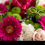 Close Up On Beautiful Wedding Bouquet Of Pink Green And White Flowers With Pair Of Rings On Top Stock Photo Alamy