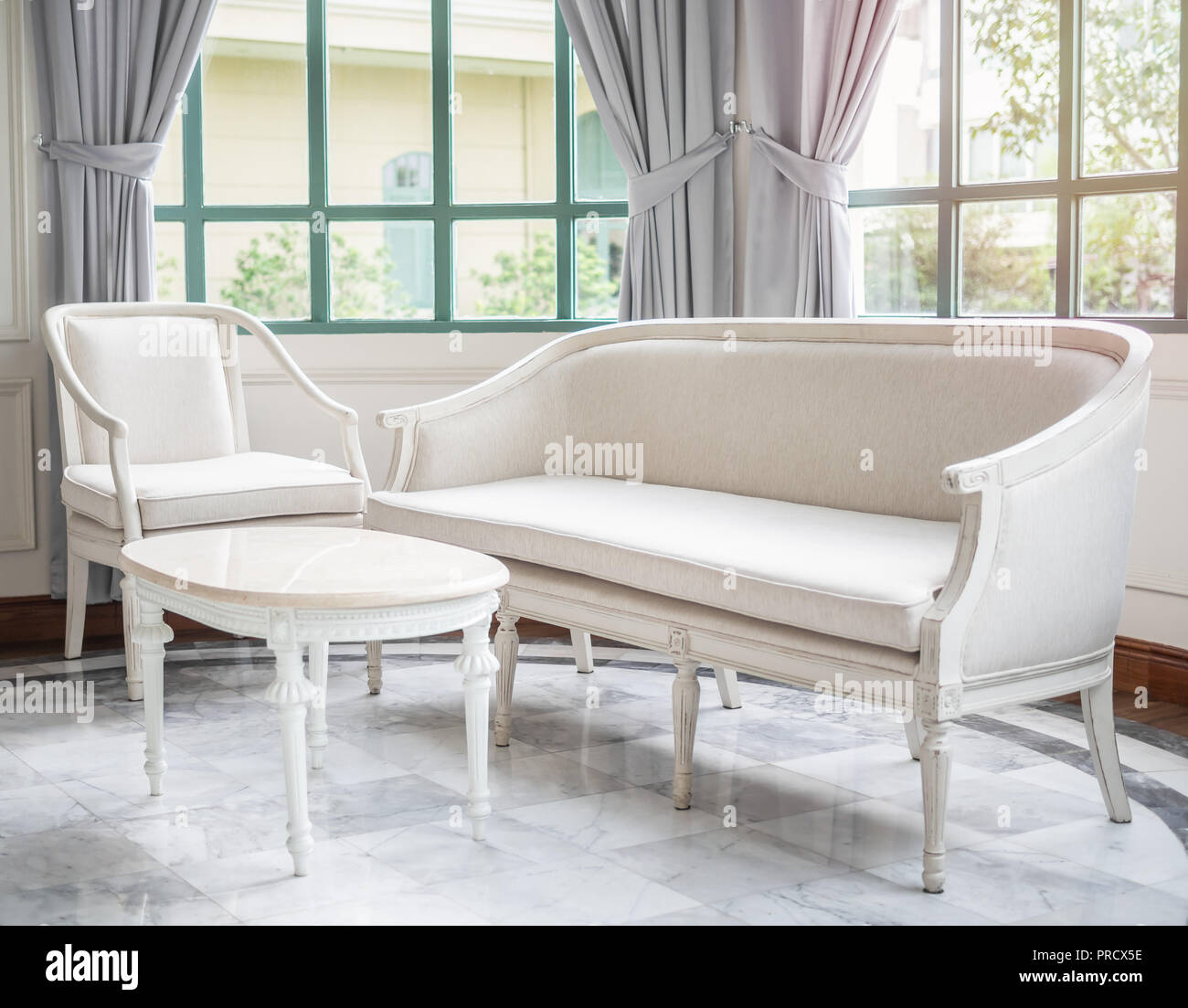 Vintage Luxury White Sofa Chair And Table Near The Window
