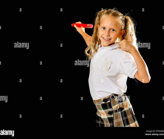 Adorable Blonde Schoolgirl In Uniform Writing On The Blackboard Feeling Happy Showing The Thumb Up Gesture Isolated On Black Background In Successful