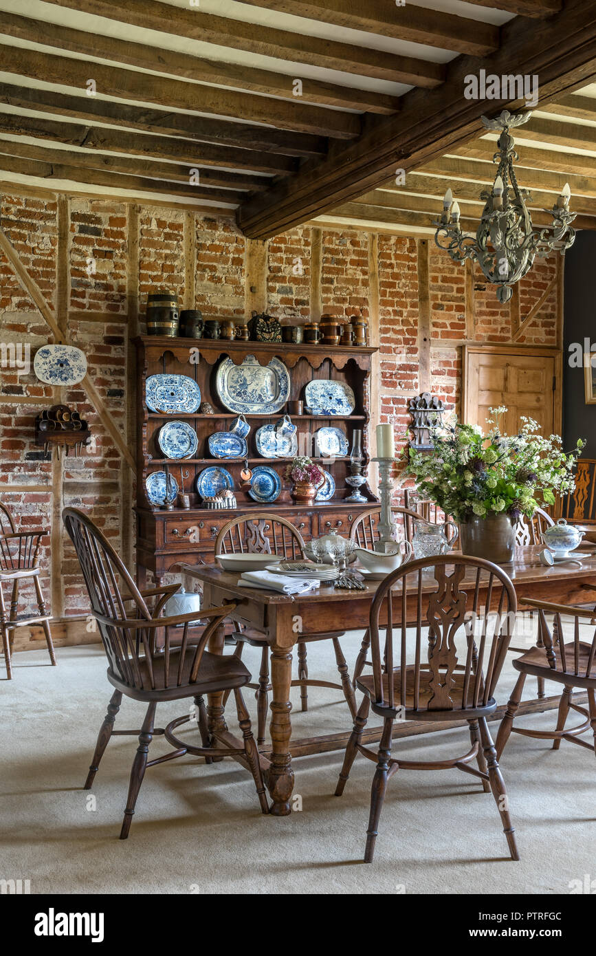 https www alamy com decorative chinaware on antique wooden dresser with table and chairs in restored 16th century farmhouse image221793276 html