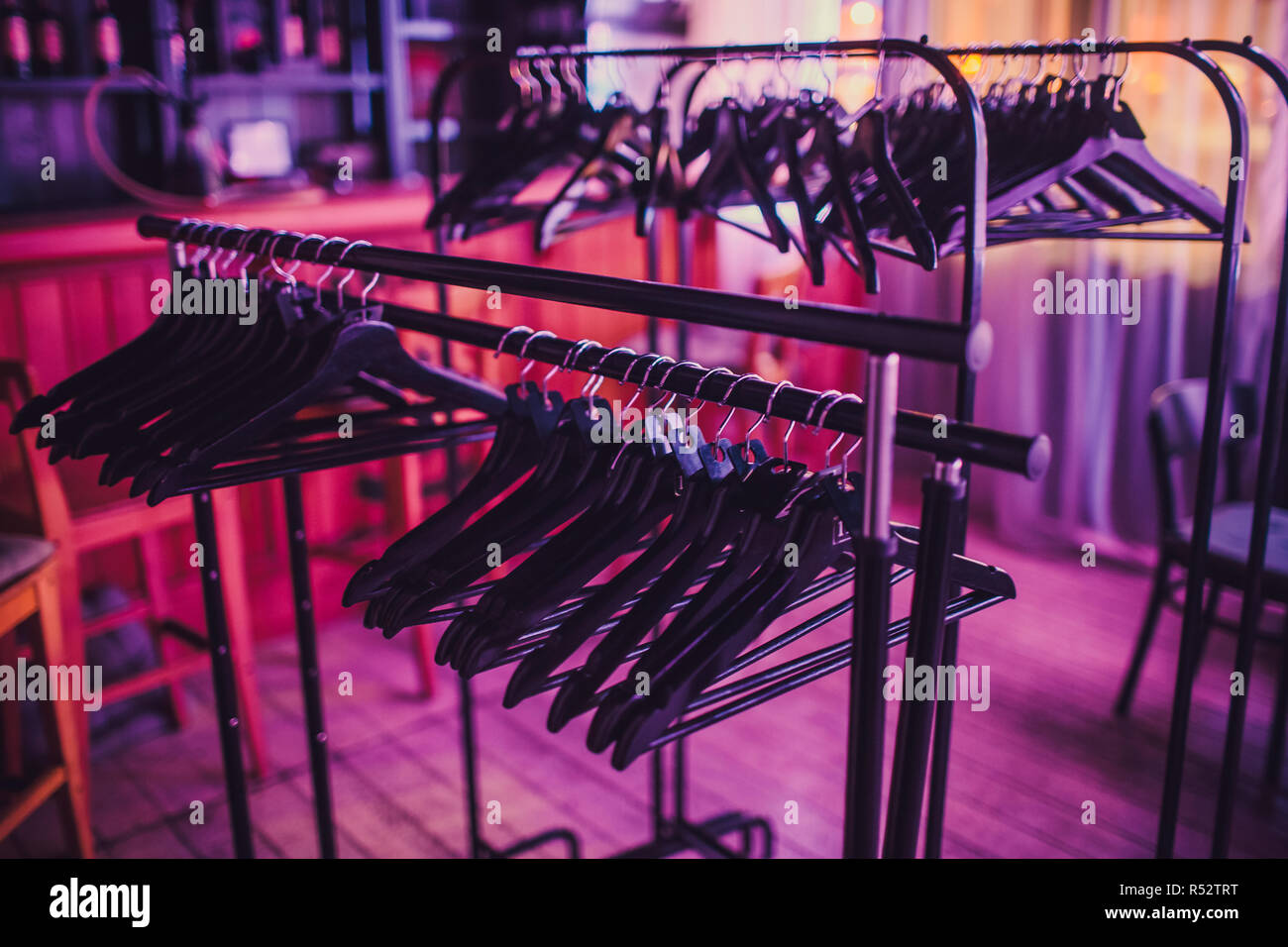 https www alamy com stock of empty clothes hanger in wardrobe wooden coat hangers hanging on a cloth rail rack in closet hotel bedroom abstract for show of suits shop after clearance sales image226871452 html