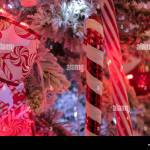 Red And White Candy Cane Christmas Decorations With Stocking Decorations On A Christmas Tree With Christmas Lights Stock Photo Alamy