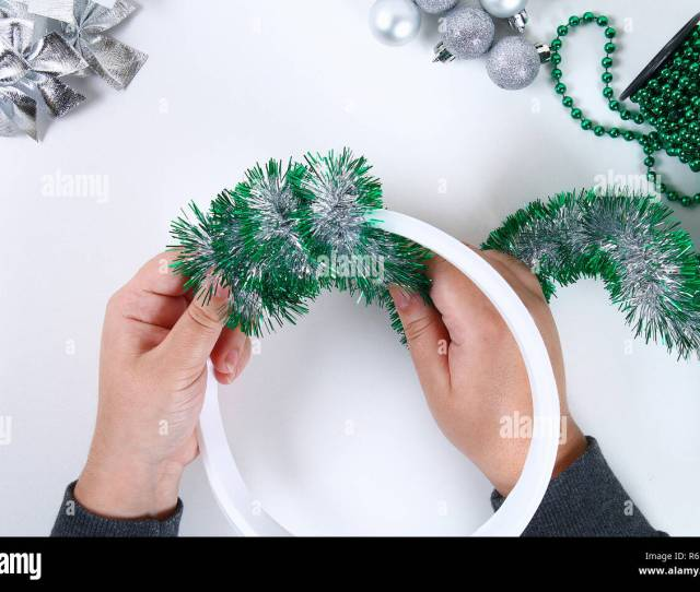 Diy Christmas Wreath Guide On The Photo How To Make A Christmas Wreath With Your Own Hands From A Plastic Plate Tinsel Beads Bows And Balls Handm