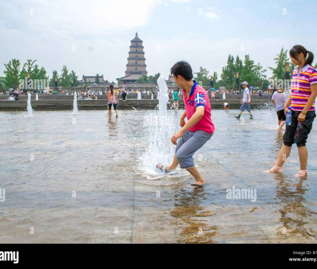 Local People Playing With The Water During Summer In The Music Fountain Dayan Pagoda Square Xian China