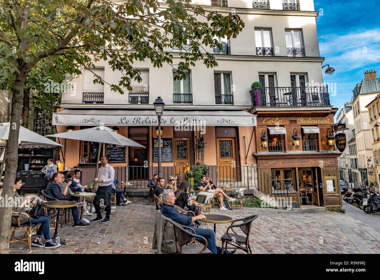 https www alamy com people relaxing at tables outside restaurant le relais de la butte whilst a waiter takes an order montmartre paris image229713446 html