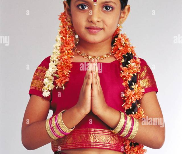 South Indian Young Girl In Traditional Costume Doing Namaste