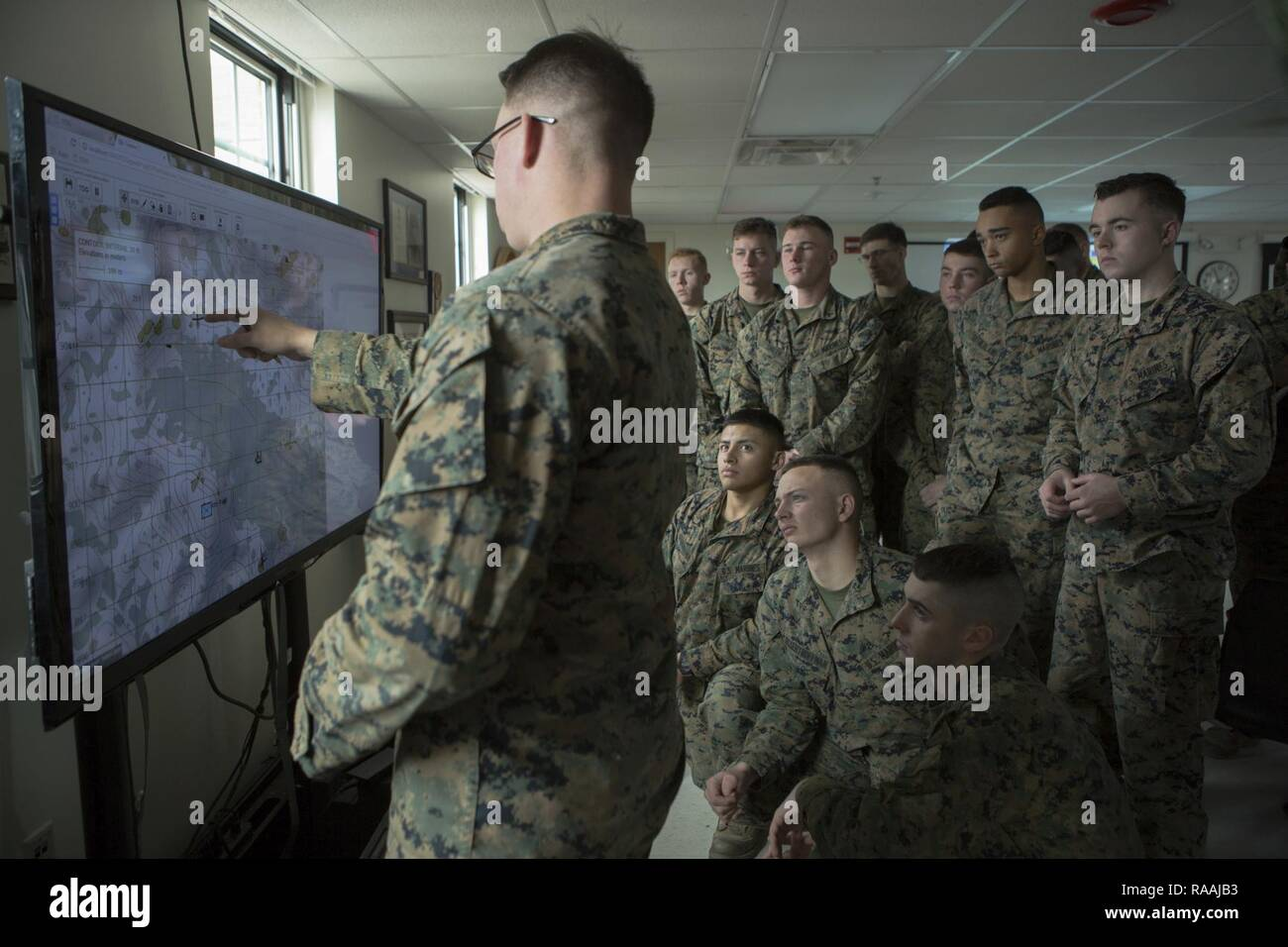This is an official u.s. U S Marine Corps Sgt Daniel A Daly A Rifleman With Echo Company 2nd Battalion 6th Marine Regiment 2nd Marine Division 2d Mardiv Utilizes A Map To Brief His Squad Before Competing In