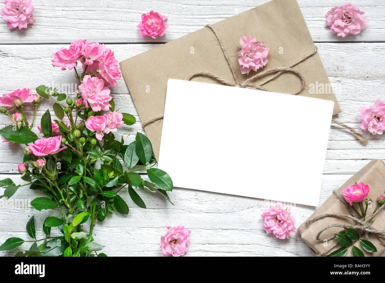 https www alamy com pink rose flowers bouquet with blank greeting card and gift box holiday background wedding invitation top view flat lay image230257663 html