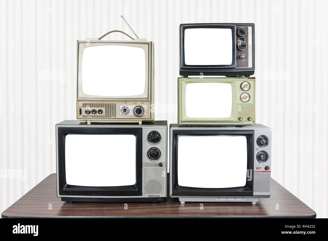 https www alamy com five vintage televisions on old wood table with cut out screens image234273454 html