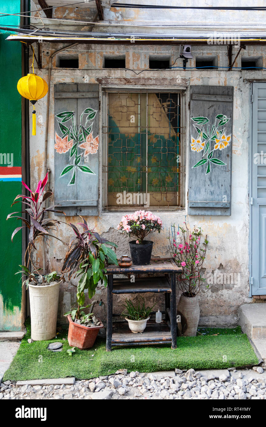 Exterior Of A Local House With Decorated Window Shutters And