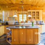 Maple Wood Island With Polished Granite Countertop And Cupboards In Kitchen With Slate Tile Floor Inside A Piece Sur Piece Eastern White Pine Log And Timber Home Quebec Canada This Image Is