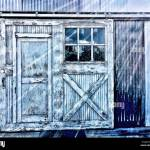 Close Up Of Sliding Barn Door With Window And Entry On Exterior Wall Stock Photo Alamy