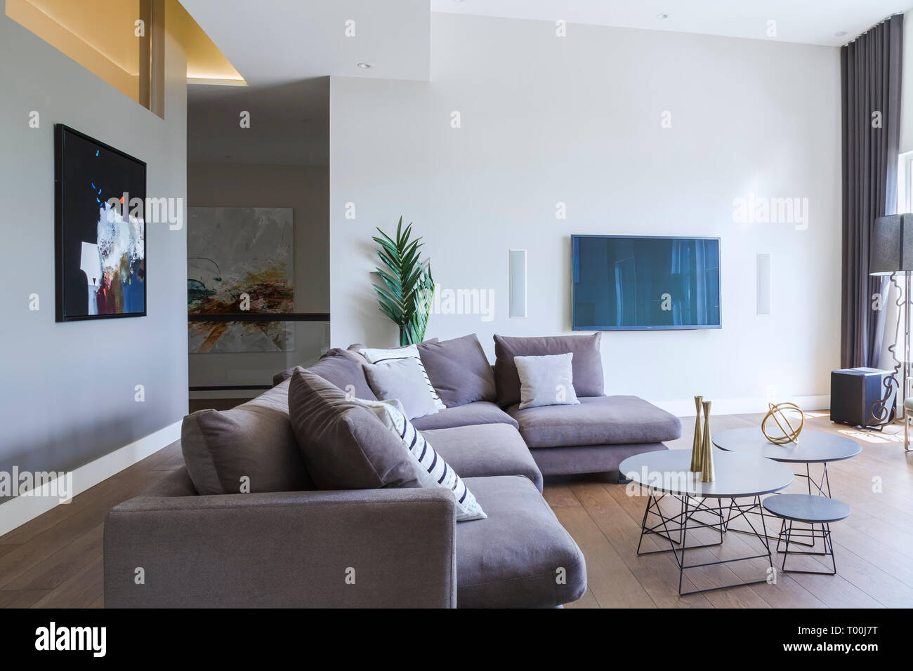 Grey Velour Sectional Sofa And Three Round Silver Lacquered