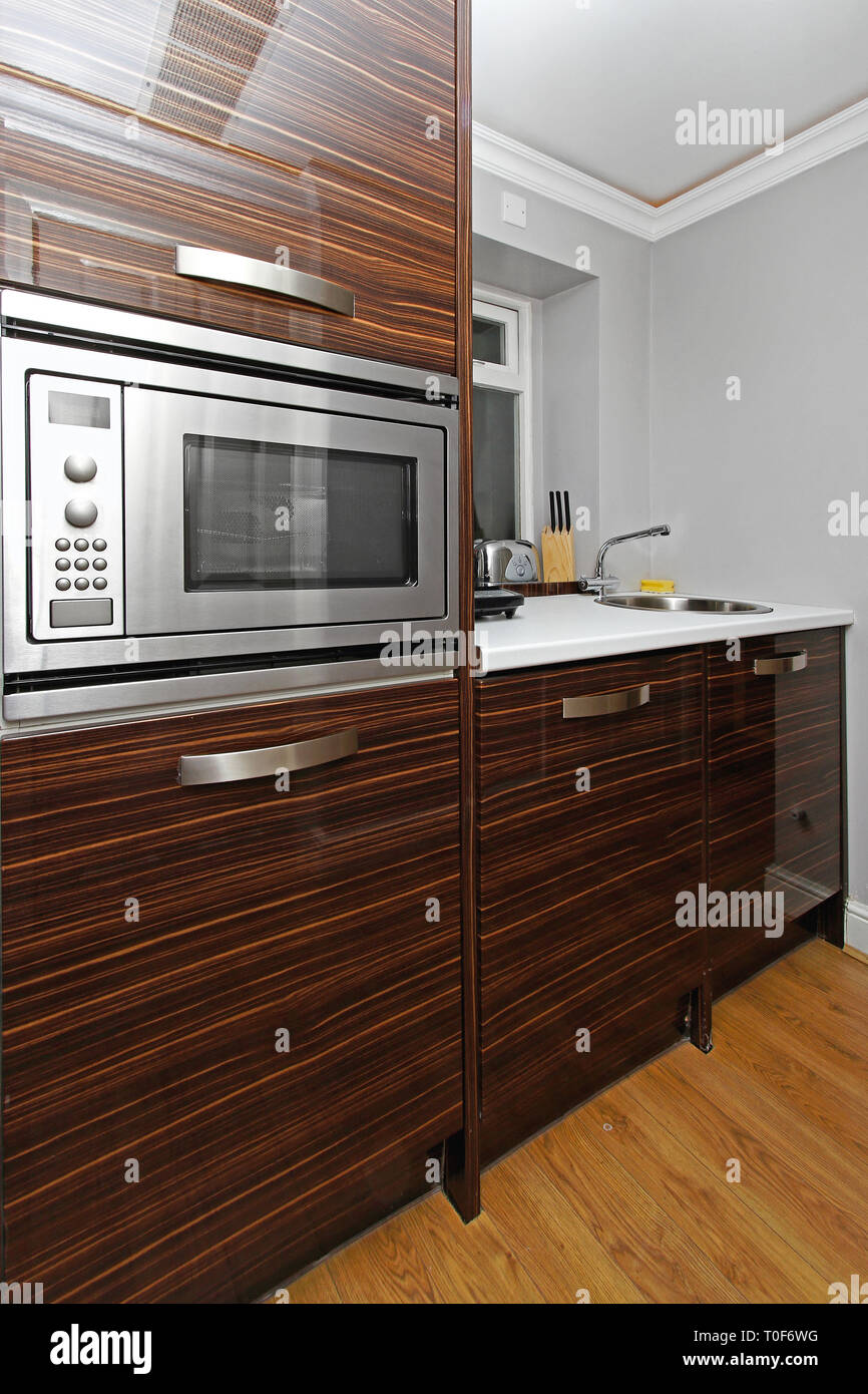 https www alamy com built in microwave oven in small kitchenette image241279852 html