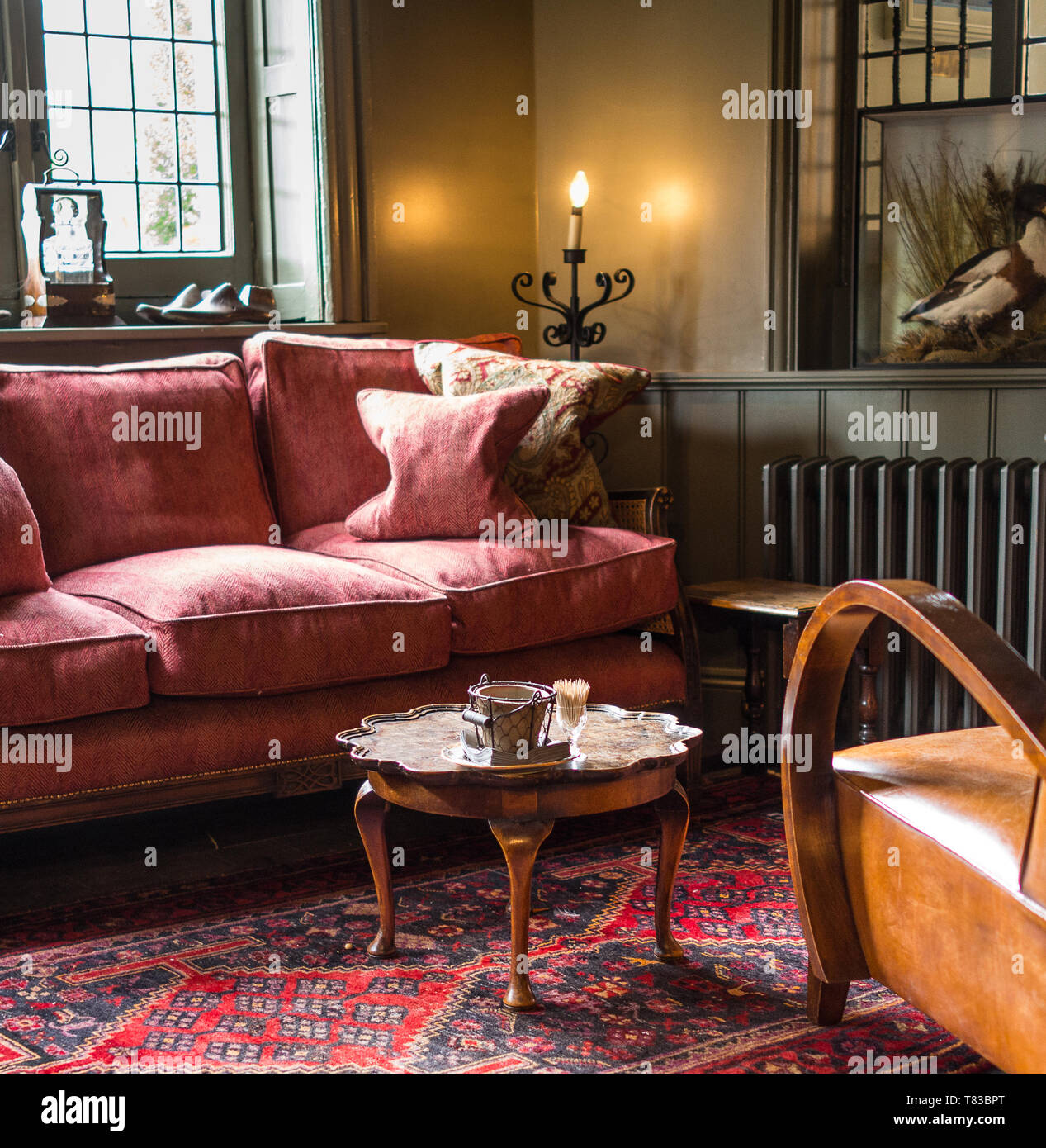 https www alamy com comfortable old pink sofa and leather chair with coffee table in old hotel image245937520 html
